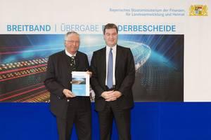 Das Bild zeigt Dr. Markus Söder (Finanz- und Heimatminister) und Alois Bauer (1. Bürgermeister)
